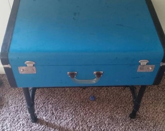 Teal end table repurposing a retro suitcase.