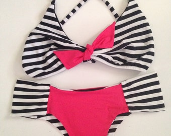 Cute Bikini swimsuit with stripes and pink fabrics