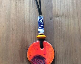 Handmade hot orange stamped glazed pendant (117)