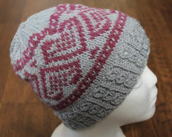 Gray and pink knit winter hat with heart motif