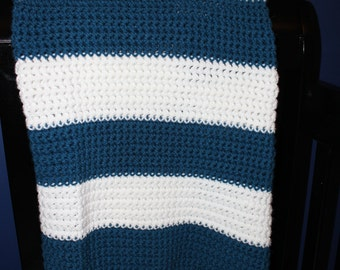 Crocheted bright blue and white baby/toddler blanket