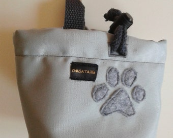 Grey dog treat bag with a colourful paw motif
