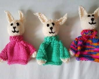Knitted rabbit egg cosies