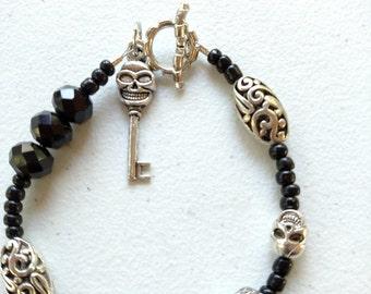 Rhinestone and silver plated bead skull bracelet