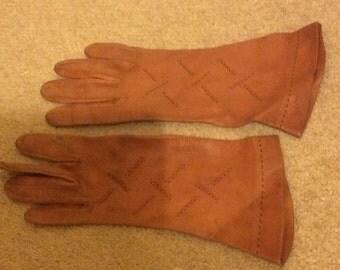 Vintage terracotta gloves with stitch embellishment.