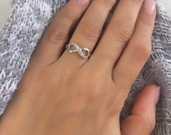 Infinity ring. Cz infinity silver ring. Cz stackable infinity gold ring. Rose gold infinity ring. Infinity design silver cz ring.