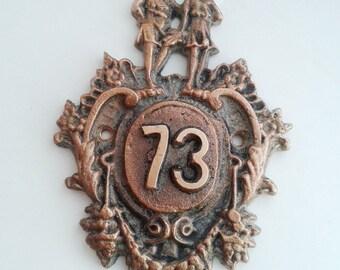 Antique door number 73, old soviet room number seventy-three