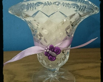 Shabby chic style candle in a vintage 1940s cut glass rose vase.