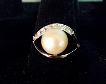 Silver ring, marked 925, with faux pearl and accents