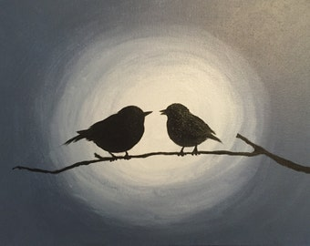 Two birds at a summer night