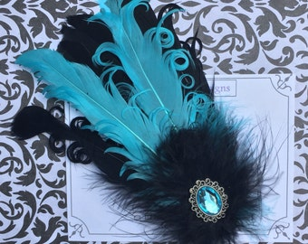 Fancy teal and black feather hair accessory with jewel!