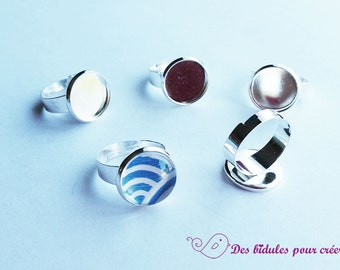 5 brackets of silver rings and 14mm glass cabochons