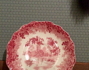 Red and white scalloped saucer