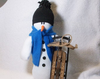 Table top snow snowman decoration with his wood sled