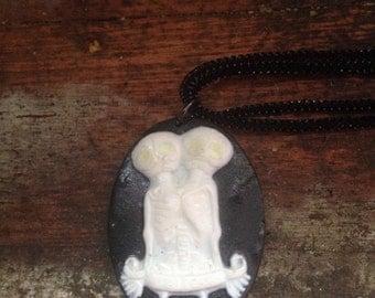 Oddity Siamese skull necklace