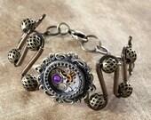 Steampunk Jewelry - Bracelet - antique watch movement and Heliotrope swarovski crystal