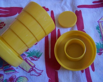 little yellow plastic travel cup