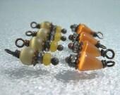 8 tiny bead dangles charms cats eye bead dangles yellow and orange