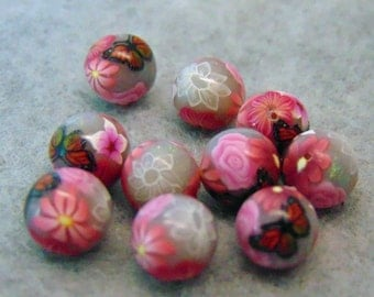 little polymer clay foiled beads with flowers and butterfly