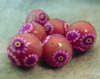 round and foiled polymer clay beads with flowers