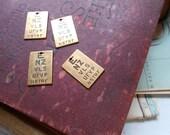4 pc brass eye chart charms  - destash jewelry supplies