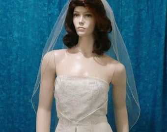traditional fingertip length wedding veil - 1 tier with a delicate pencil edge
