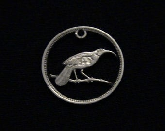 New Zealand - cut coin pendant -  Huia Bird on Branch - 1965