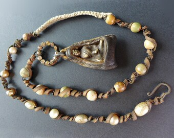 Paregoric. Rustic assemblage necklace with Buddhist reliquary.
