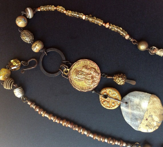 Wayward Wayfarer. Gold colored rustic assemblage Victorian tribal necklace with Mary medal.