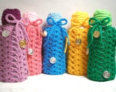 Bottle Banks are making a change. Upcycled plastic bottle banks handmade with crocheted tops.