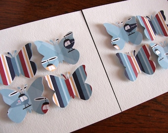 Inventory CLEARANCE SET of TWO 5x5 inch 3D Butterfly Art Creations As Shown. Red, Navy, Blue Gray. Helicopters, Stripes