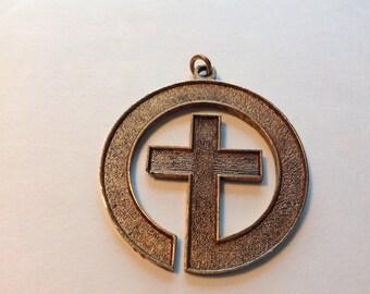 Vintage metal cross pendant