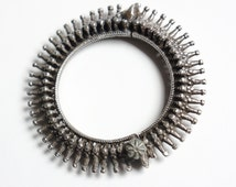 Old antique silver tribal bracelet from Madhya Pradesh, India with spikes