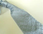 Vintage men's tie. Silk, DKNY, light blue, diamond texture, classic, made in USA.