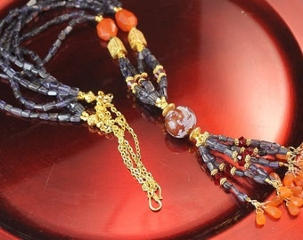 The Turandot Exotic Tassel Necklace in Blue Iolite, Carnelian, Swarovski Crystals, Red Agate, Bali Vermeil Beads, and bali Vermeil S Clasp