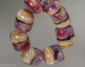 Boro beads, (qty 8) Lampwork Glass Bead Set, Tan swirl base with Red-violet and black accents   SRA Artisan beads ---  #190