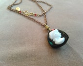 vintage glass cameo and brass necklace