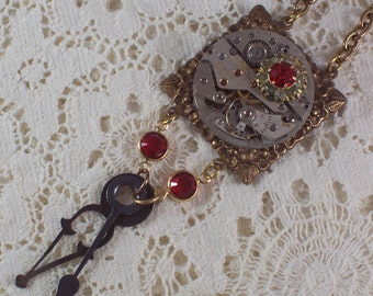 Steampunk Red Clock Hand Assemblage Necklace by ceeceedesigns on etsy