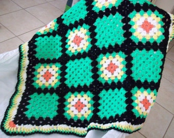 Baby Crochet Granny Square Throw Afghan in glowworm (green), tangerine, white, and lemon edged in black