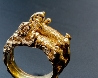 Otters holding hands rings in solid gold Blue Bayer Design NYC