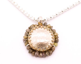 Raw diamond pendant around a lace gold  and silver setting