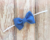 Blue suede bow
