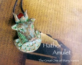 Hathor Amulet - Cow Head with Horns and Carnelian Disc - Egyptian Goddess- The Great One of Many Names - Polymer Clay Pendant - Brass Patina