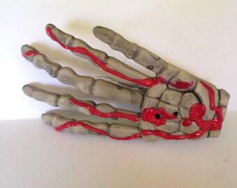 Bloody skeleton hand