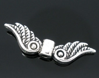 50pcs. Antique Silver Wing Spacer Charms Pendants - 23mm X 7mm