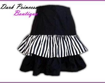 10% off. Black and white striped, ruffled mini skirt