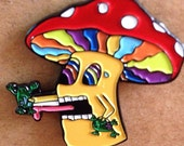 Mushroom licking a toad hat pin, lapel pin, shroom, trippy, psychedelic, hippie, music festivals, hat pins
