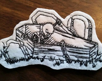 skeleton in coffin patch,