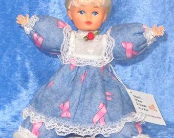 EmilyAnn, cute Caucasian vinyl doll pink ribbon breast cancer doll