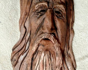 """Clay face sculpture, Wilderness Watch"""" wallhanger, Don Reardon"""